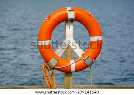 life belt, rescue ring (63) water in background - stock photo