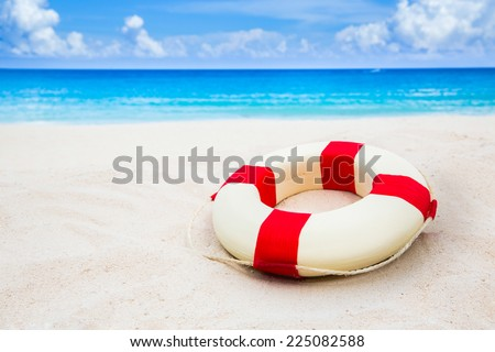 Life buoy at the beach - stock photo