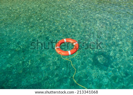Life buoy for safety at sea - stock photo