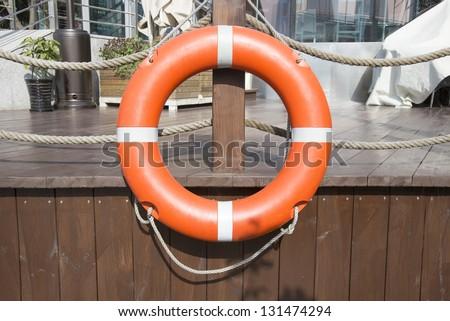 Life buoy hanging - stock photo