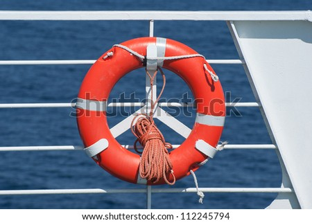 Life buoy on ferry crossing the mediterranean sea to Santorini island, Greece - stock photo