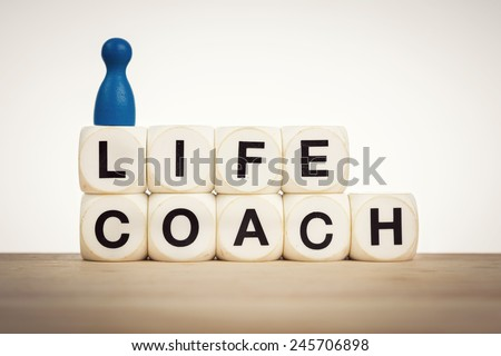 Life coach concept - aim towards helping people identify and achieve personal goals - stock photo