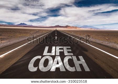 Life Coach written on desert road - stock photo