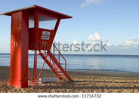 Life guard stand at sunrise on the beach - stock photo