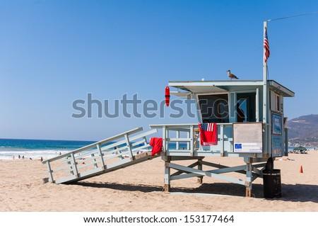 Life Guard Tower under the blue sky in Malibu Beach - stock photo