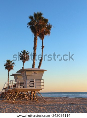 Life guard tower with palm trees as the sun sets in California  - stock photo