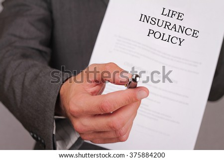 Life insurance concept. Man offering a pen to sign policy close up.
