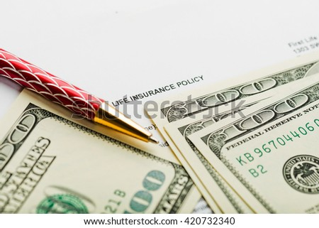 Life insurance with dollars and pen - stock photo