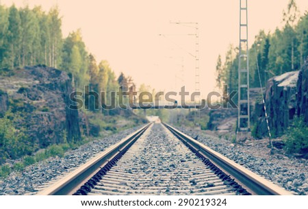 Life is a journey as a thought. Image of an empty railroad. Also image has a vintage effect.