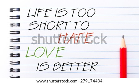 Life  is Too Short To Hate Love is Better Text written on notebook page, red pencil on the right. Motivational Concept image - stock photo