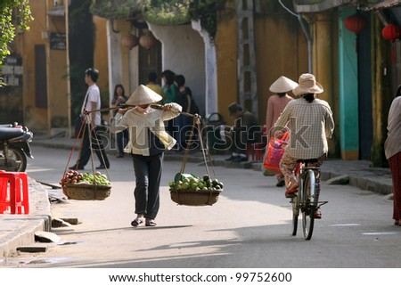 Life of vietnamese vendor in Hoi An, Vietnam - stock photo
