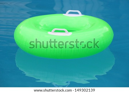 Life ring floating on blue water.