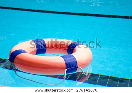 Life ring in swimming pool - stock photo