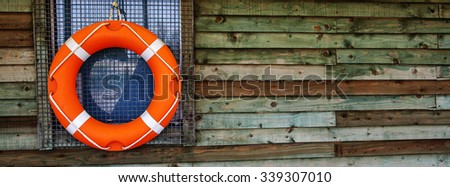 Life Ring / Life Preserver / Life Buoy panorama / banner / header - for water sports, sailing, fishing, swimming and safety. - stock photo