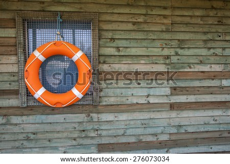 Life Ring / Life Preserver or Life Buoy, on Hut, for sailing, water sports, lifeguard duty and safety. - stock photo