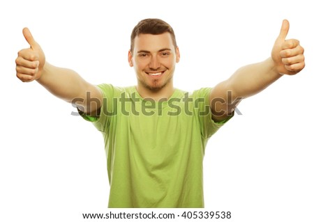 life style  and people concept: casual young man in shirt  with both hands raised in the air. Winner and happy.