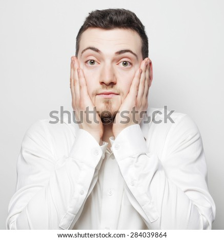 life style, business  and people concept: Young business man  with a headache or problem - stock photo