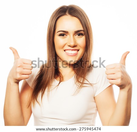life style, happiness, emotional  and people concept: Beautiful young  woman wearing white shirt looking at camera and make different emotions while standing against white background  - stock photo