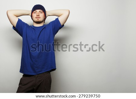 Life style, sport and people concept - young handsome man in blue t-shirt and blue hat. - stock photo
