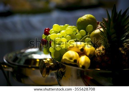 life with fruits. Mixed fruits in  silver bowl - stock photo