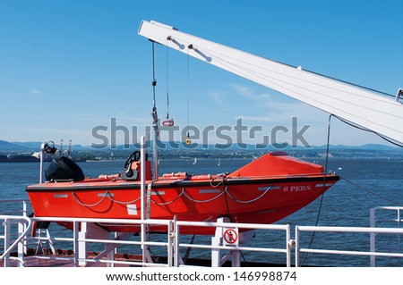 Lifeboat hanging on a deck of cruise ship - stock photo