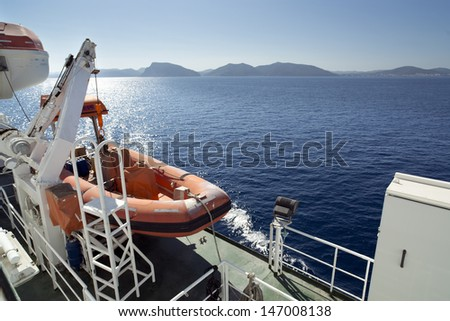 lifeboat on a ferry in the mediterranean - stock photo
