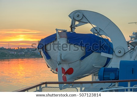 Lifeboat on deck at sunset light