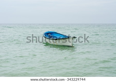 Lifeboat with paddle. Old wooden boat - stock photo