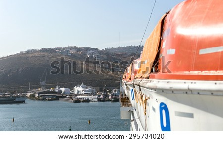 Lifeboats on cruise ship - stock photo