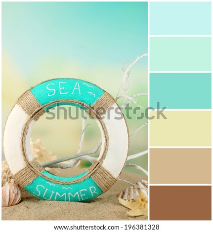 Lifebuoy and sea shells on sand. Color palette with complimentary swatches - stock photo