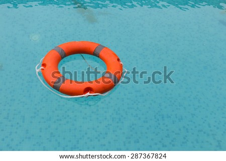 lifebuoy in the swimming pool - stock photo