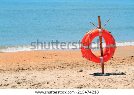 lifebuoy on a beach - stock photo