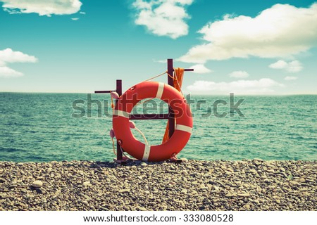 Lifebuoy on a sea background/beach season/vintage instagram effect/summer rest - stock photo