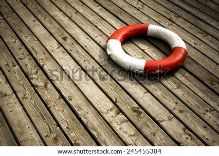 Lifebuoy on a wooden background