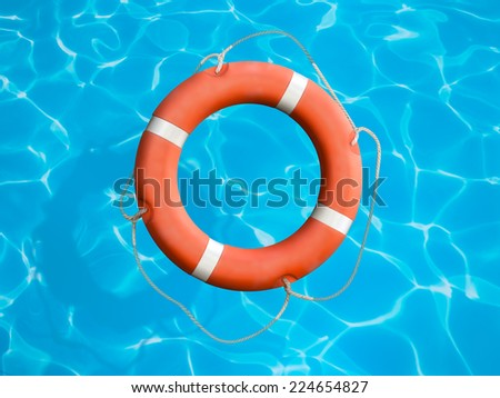 Lifebuoy on blue water surface