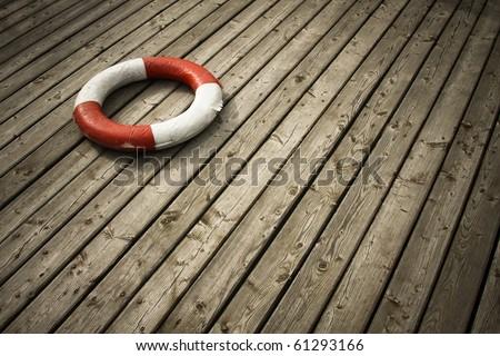 Lifebuoy on the board - stock photo