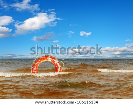 lifebuoy ring in the sea  under blue sky