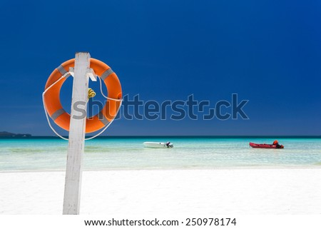 Lifebuoy ring on tropical beach, Boracay  - stock photo