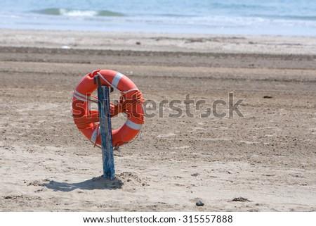 lifebuoy. The famous Lido Beach of Venice, Italy. - stock photo