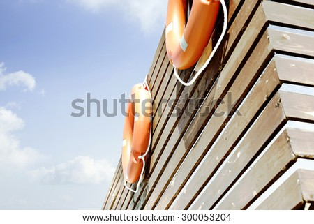 Lifebuoys on the fence - stock photo