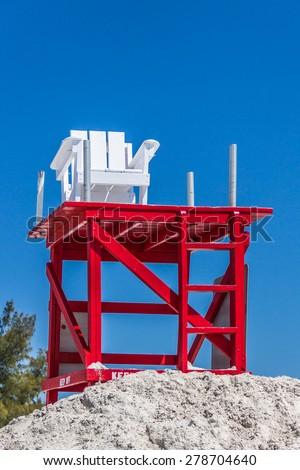 Lifeguard chair at the beach - stock photo