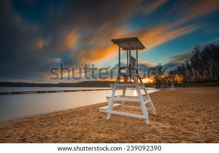 lifeguard hut on lake beach. long time exposure photo - stock photo