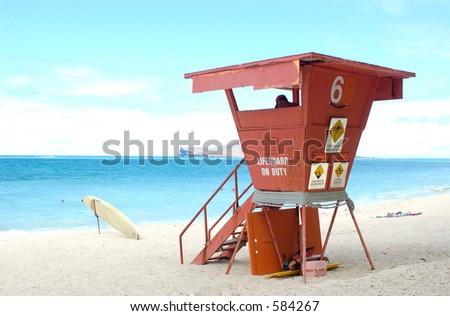 Lifeguard on duty in tower - stock photo
