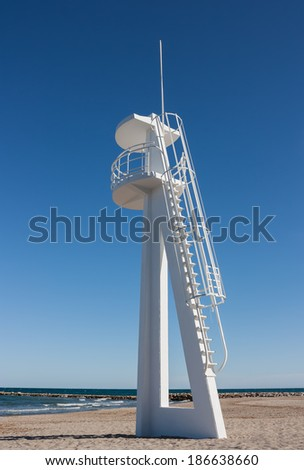 Lifeguard or baywatch tower on beach against blue sky.  - stock photo