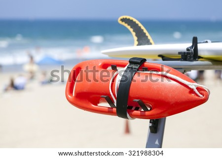 Lifeguard red buoy on a beach, shallow depth of field, space for text, California, USA. - stock photo