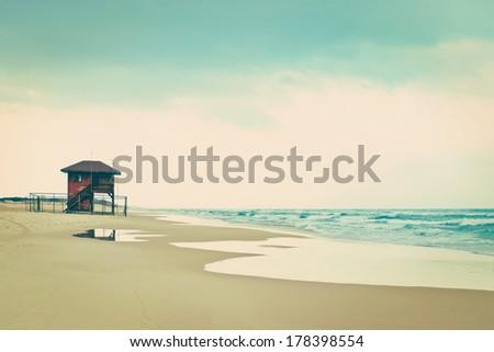 Lifeguard shack on an empty beach, Mediterranean Sea. Vintage style. - stock photo