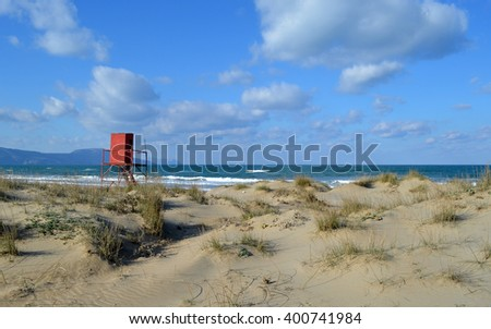 Lifeguard Station in distance on Greek beach - stock photo