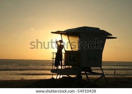 lifeguard station sunset - stock photo