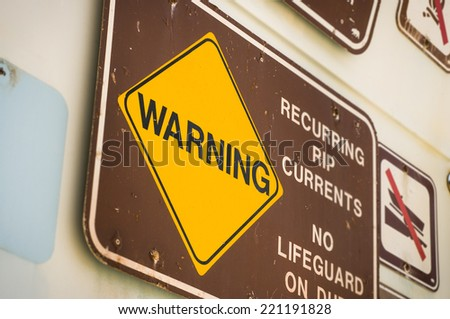 Lifeguard station warning sign at beach - stock photo