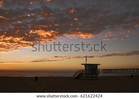 Lifeguard station with american flag on Hermosa beach at sunset, California, USA